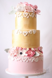 gold and pink with sugar flowers from london designer sugared saffron