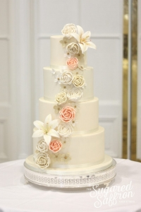 Champage and lilies luxury wedding cake London
