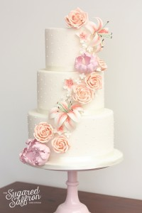 Soft cascade of sugar flowers from modern wedding cake maker in london