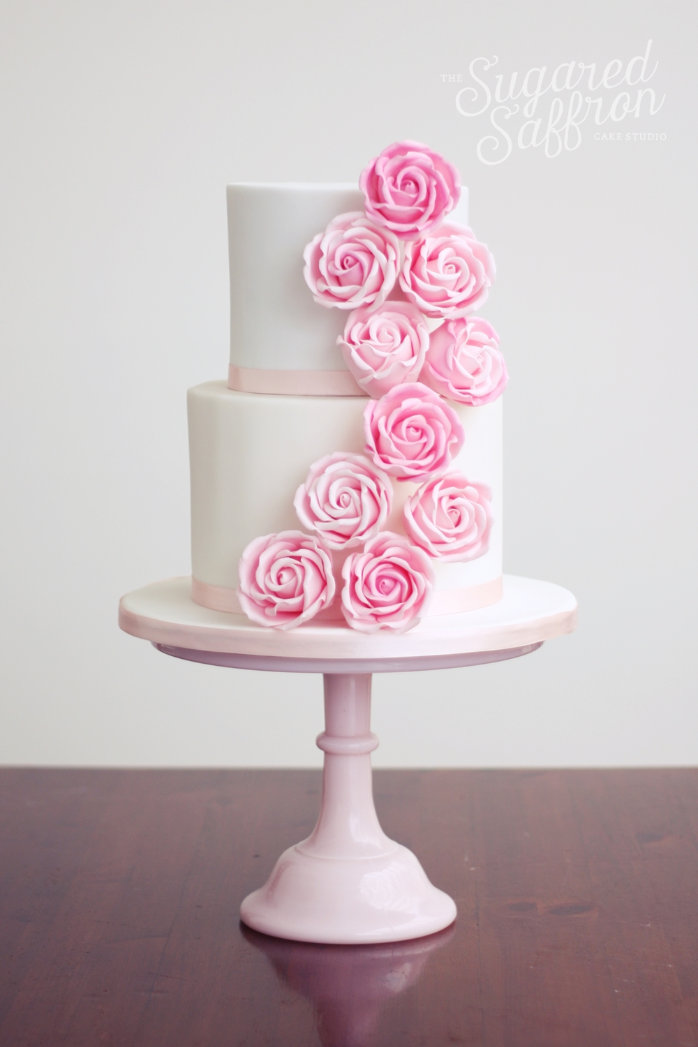 Pink roses wedding cake london
