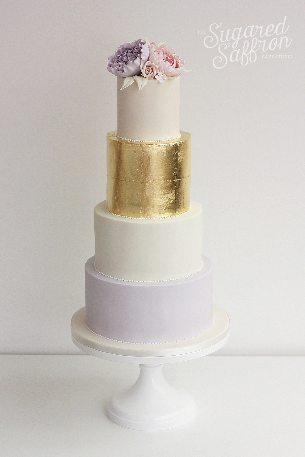 Gold leag and peonies luxury wedding cake london