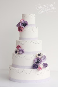Purple cake with sugar flowers, London based wedding cakes