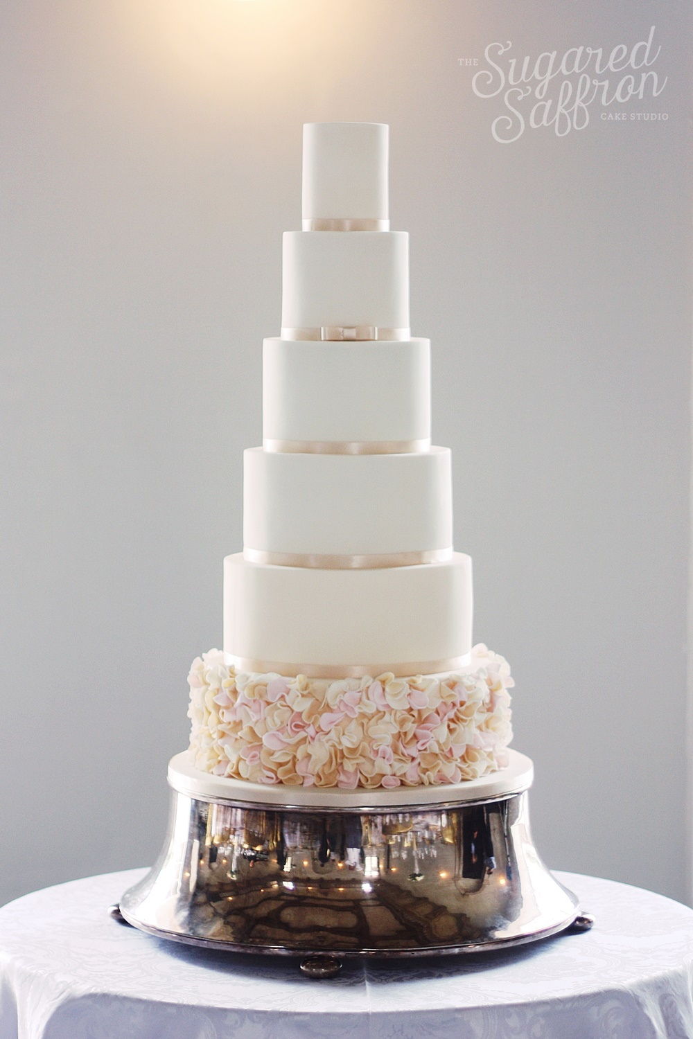 london wedding cake with ribbon and ruffles