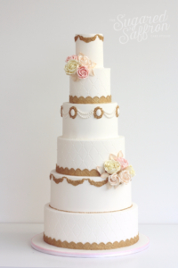 Gold, pink and peach designer cake by Sugared Saffron in London