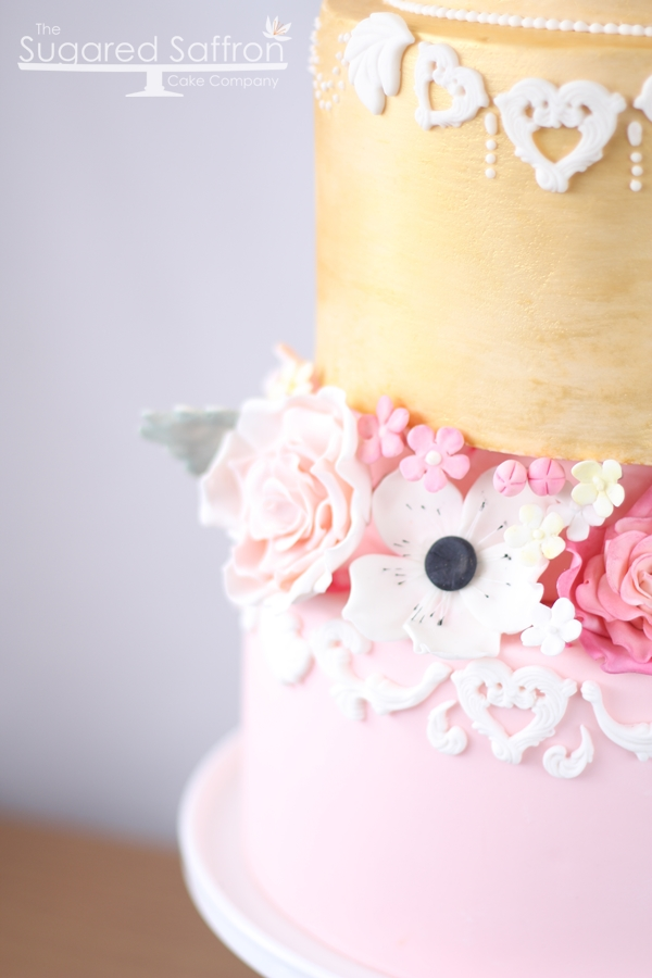 Gold cake tier with flowers