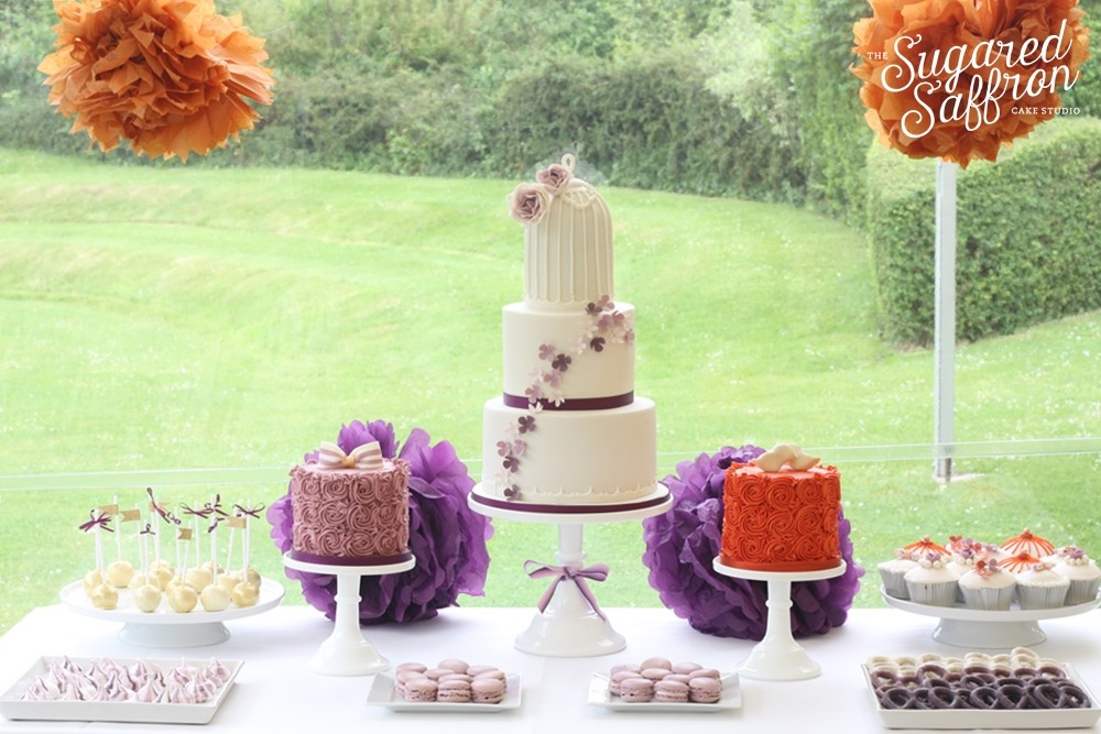 Orange and purple dessert table