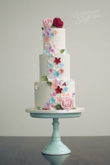 falling flowers in pink, blue, peach, red wedding cake