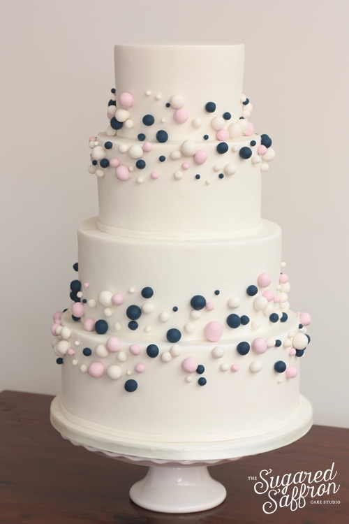 Blue pink and white abstract bubbles balls wedding cake