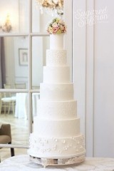 tall white wedding cake with different textures at mandarin oriental