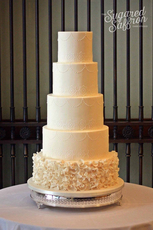 arabic geometric design on ivory cake with ruffles
