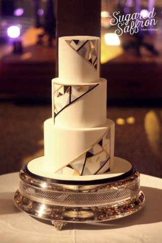 Modern art deco wedding cake with triangles in black gold lilac