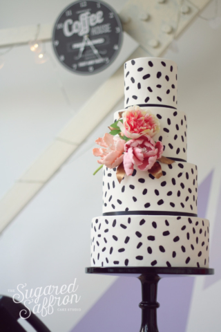 Black brush stroke wedding cake with pink flowers