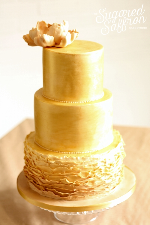 Brushed gold wedding cake with ruffles