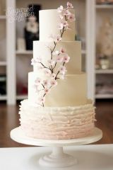 ivory with pink ombre ruffles and cherry blossom plant and flowers