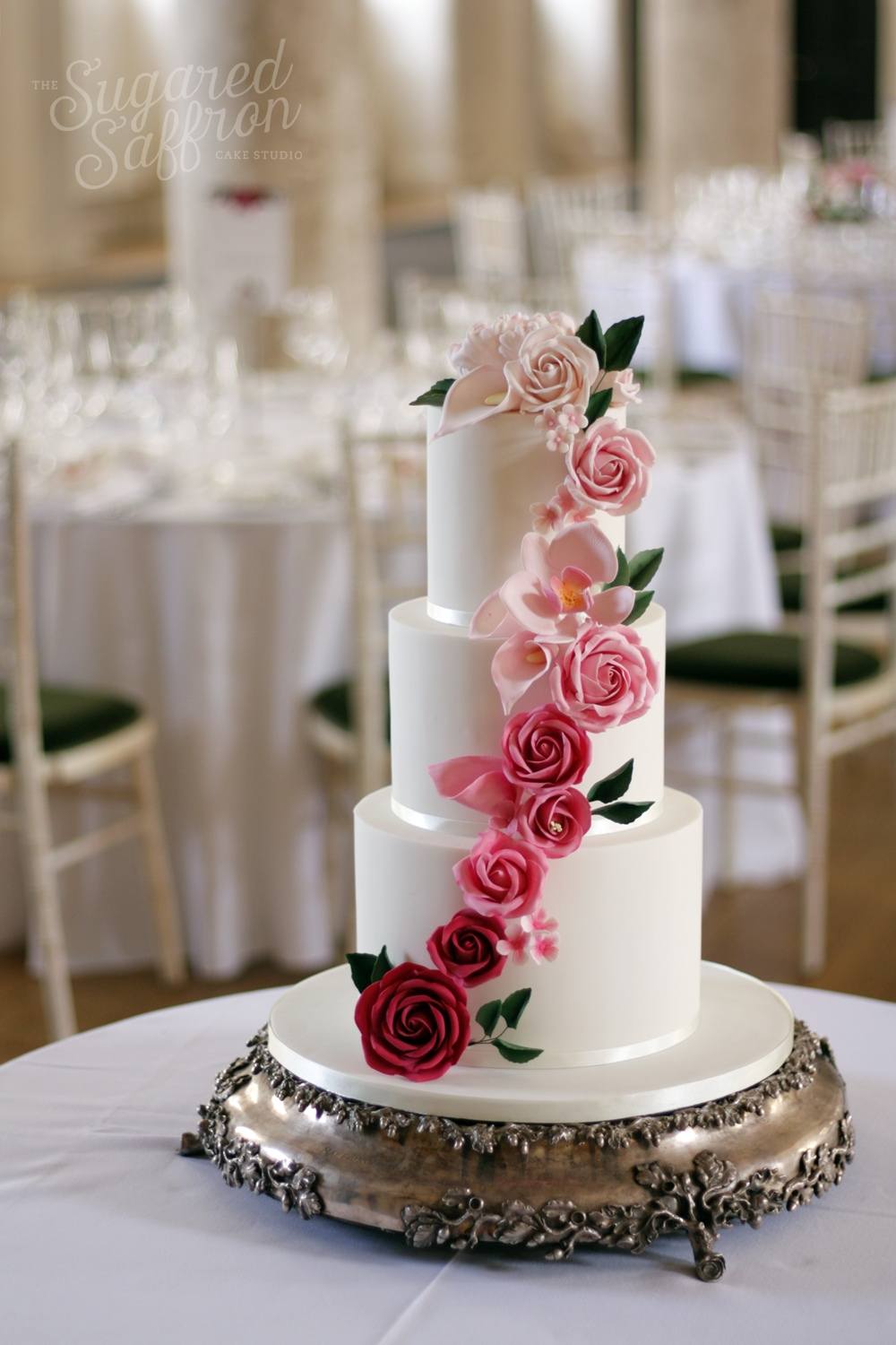 dark to light pink cascade of sugar flowers on white wedding cake