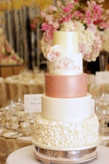 ivory wedding cake with dark rose gold at the grove in watford