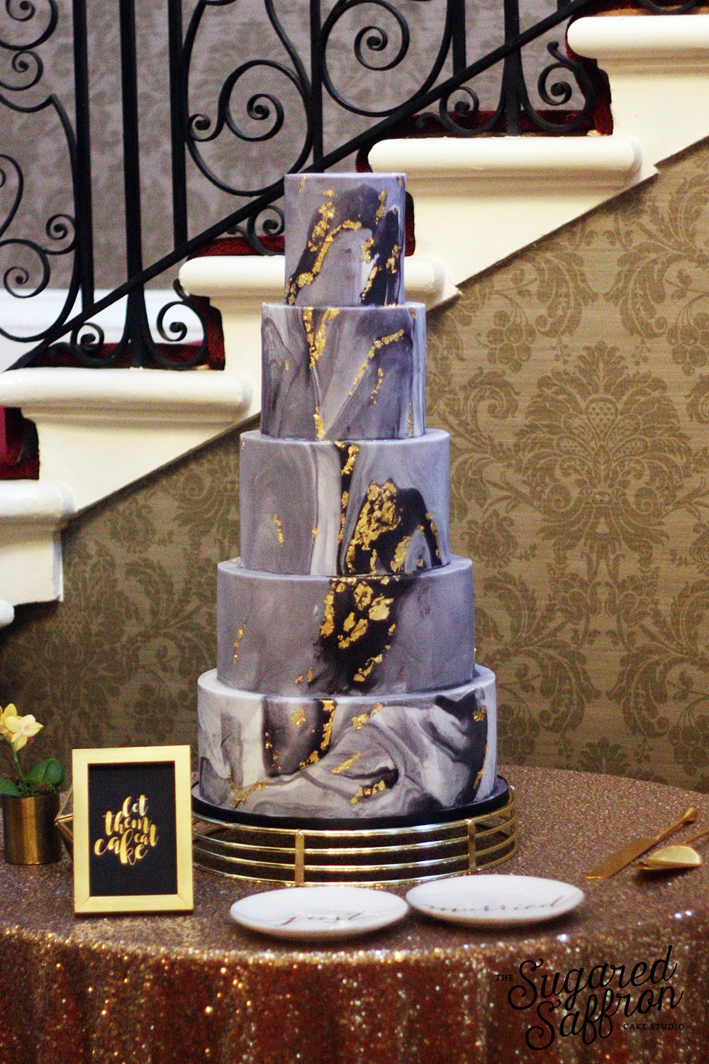 Dark grey and black marble wedding cake with gold leaf at hedsor house