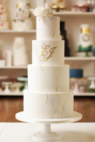 engraved gold monogram on marble wedding cake