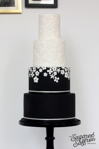 black and white cake with fabric flowers