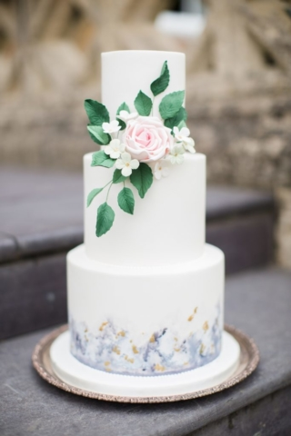 foliage with blue watercolour design wedding cake