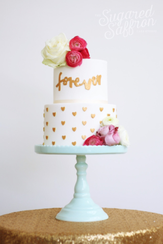 calligraphy forever wedding cake with small hearts and fresh flowers
