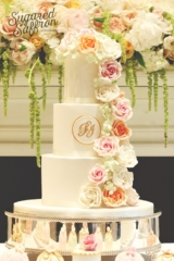 cascade of peach pink white roses on a white wedding cake at the savoy hotel london