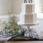 Hexagon marble wedding cake with gold letter toppers