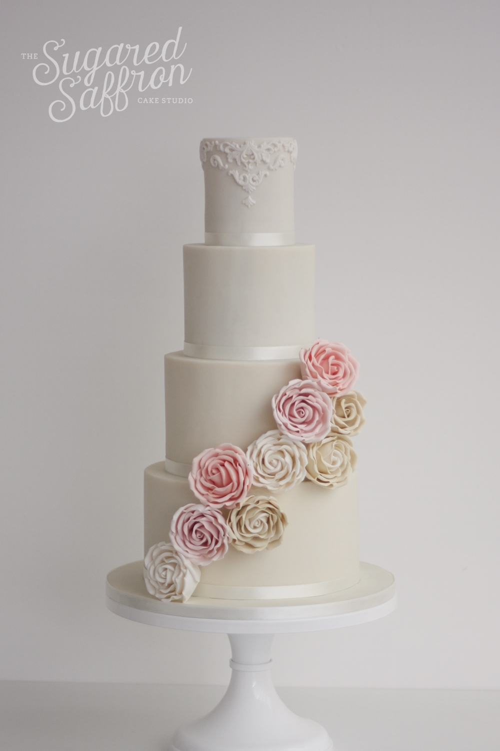 ivory cake with half a cascade of sugar flowers