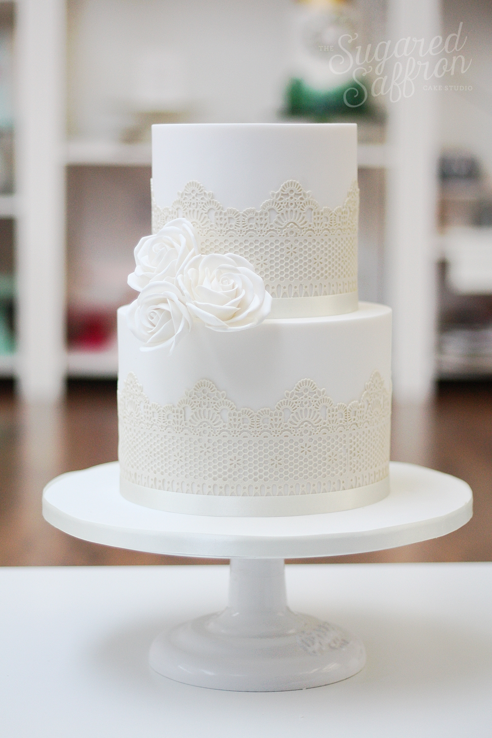 ivory edible lace on white cake