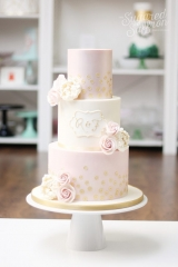 Pink shimmer and ivory wedding cake with matching roses