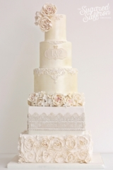 ivory shimmer cake baroque scrolls and sugar roses