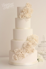 white cake with ivory roses in a large split cascade in lodnon