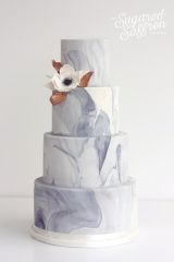 Large marble effect cake with anemone