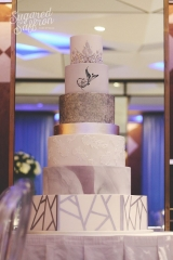 Tall cake in lilac with silver elements and arabic