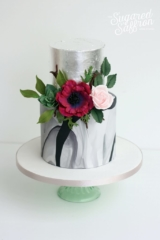 dark pink anemone with dark marble and silver leaf.
