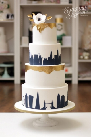 new york and london skyline wedding cake in navy and gold