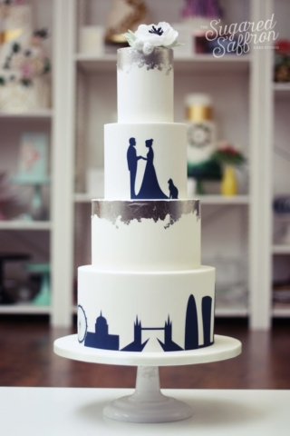 navy silhouette of couple and london skyline with silver