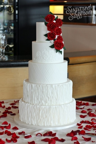 oscar de la renta ruffles on white wedding cake with red roses