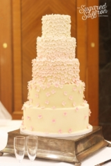 ombre pink hydrangea and ivory wedding cake