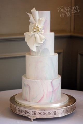 Wedding cake with pastel marbling and folded design