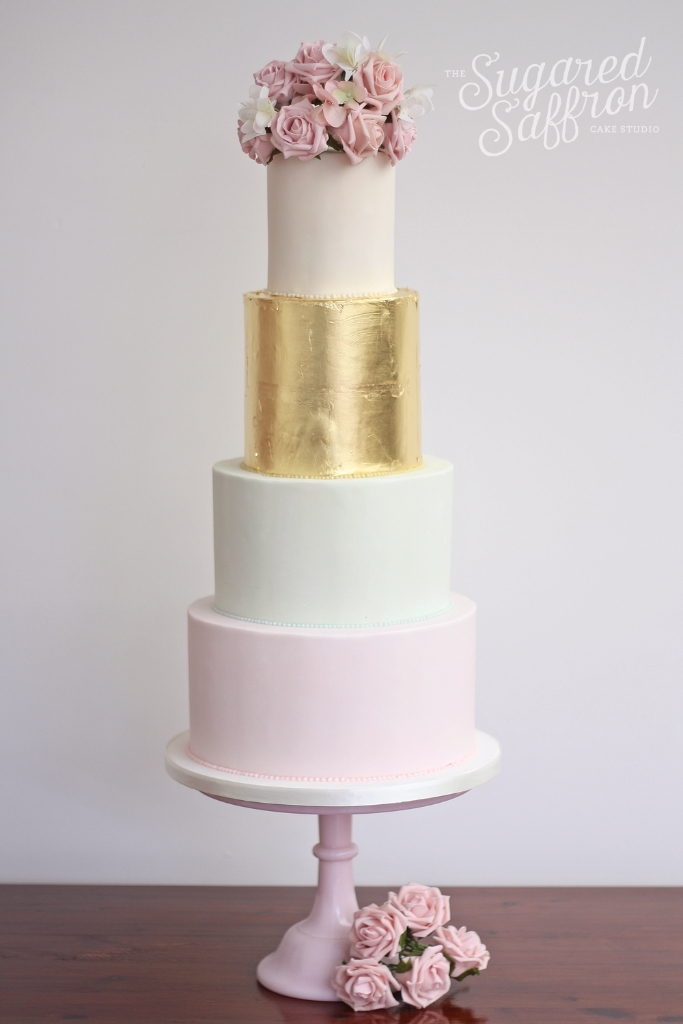 Pale mint and pink with gold leaf wedding cake and flowers