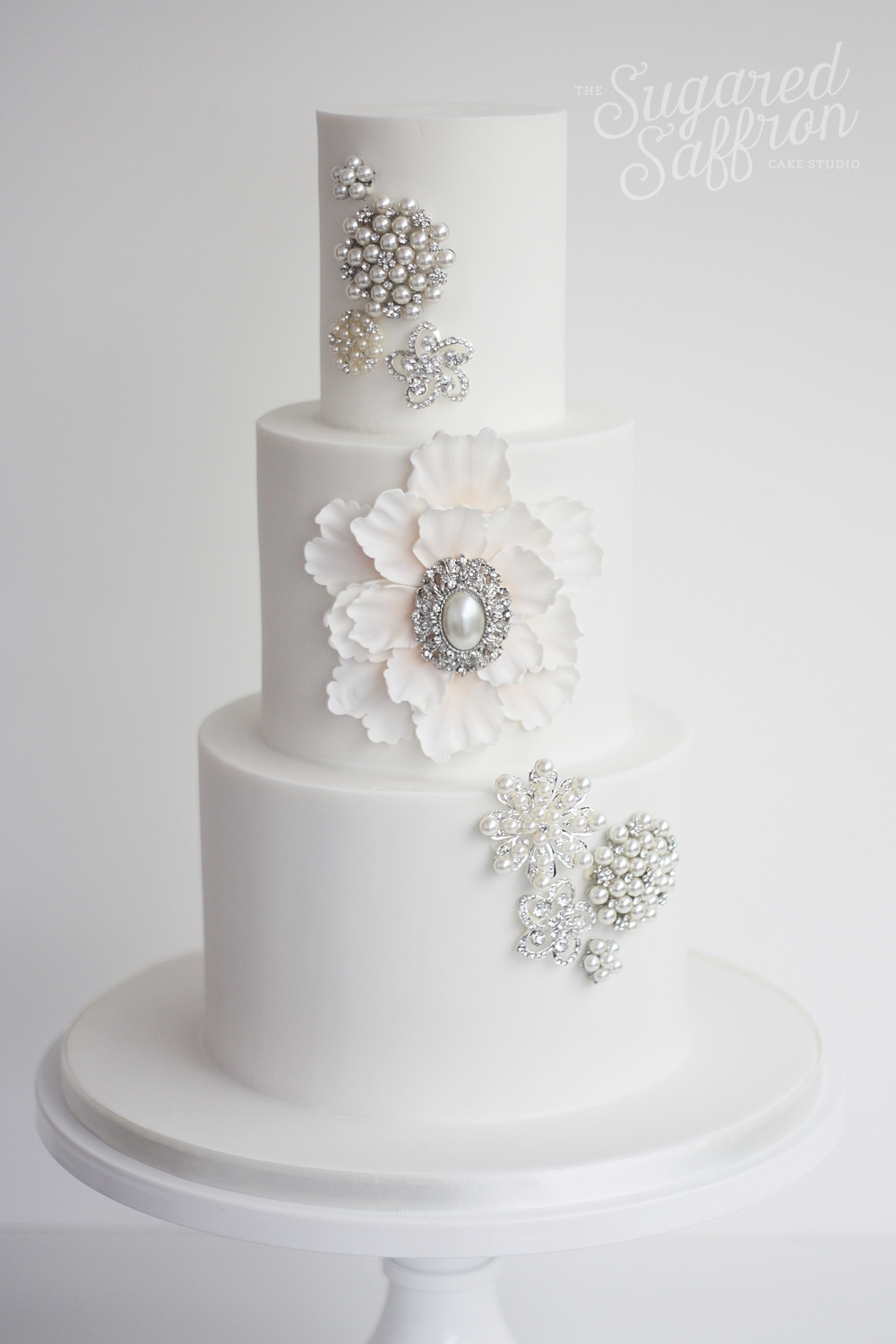 white wedding cake with brooch design