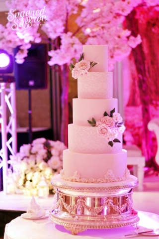 Pink and ivory cake with damask and sugar roses