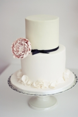Pistachio colour cake with ruffles and pink peony