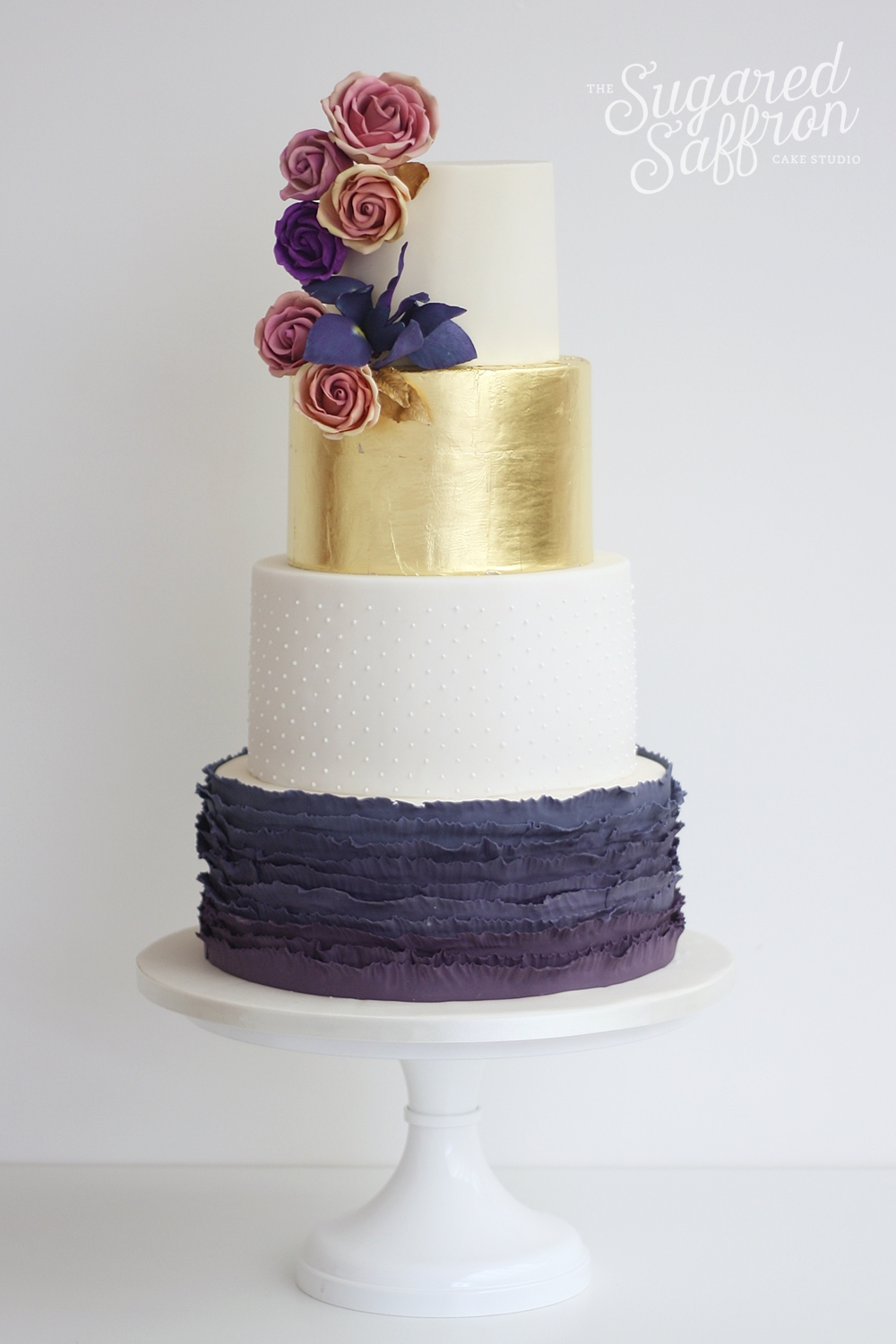 Purple ruffles, gold leaf and sugar amnesia roses and blue iris