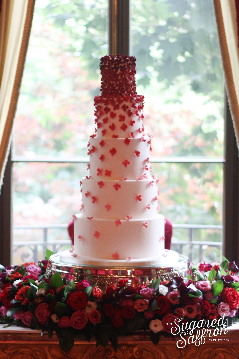 falling ombre red hydrangea wedding cake
