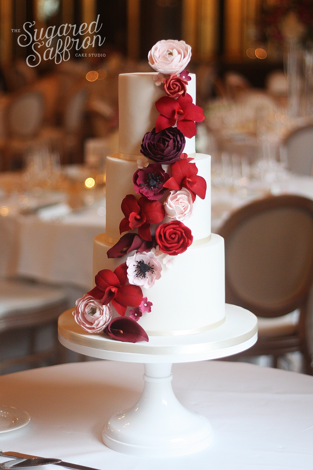 White cake with Red & Burgundy sugar flower Cascade
