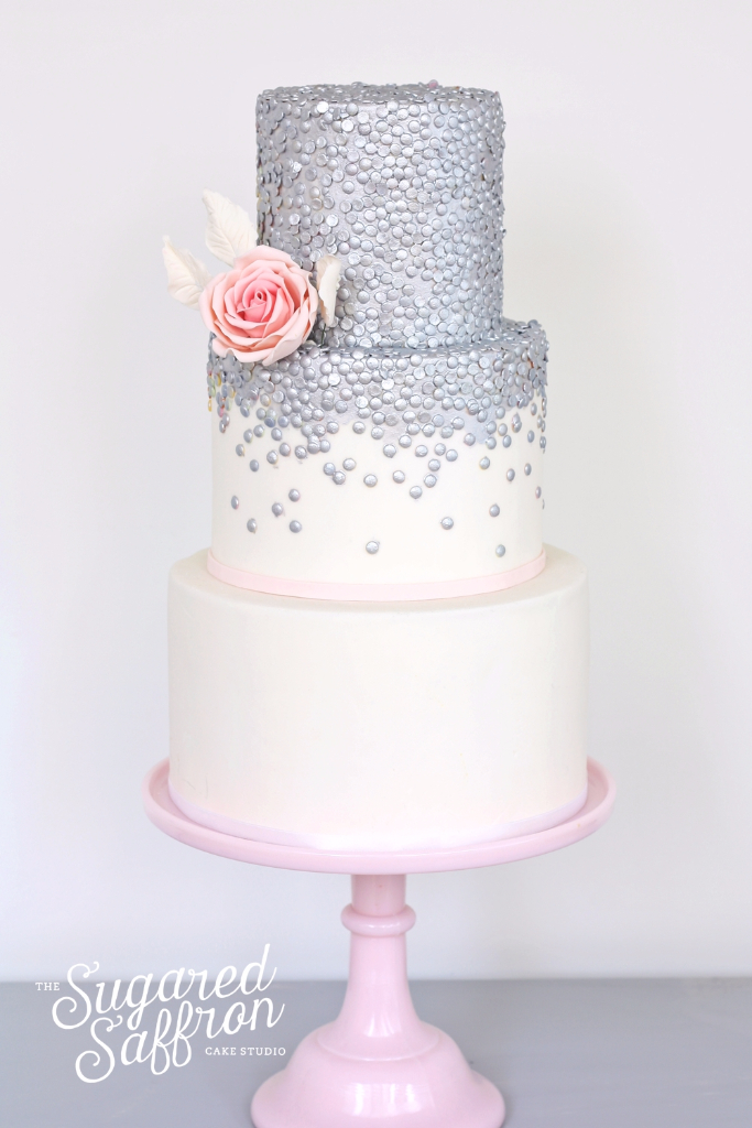 Silver sequin wedding cake with pink border and rose