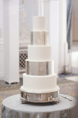 silver leaf and white alternating tiers wedding cake at the savoy