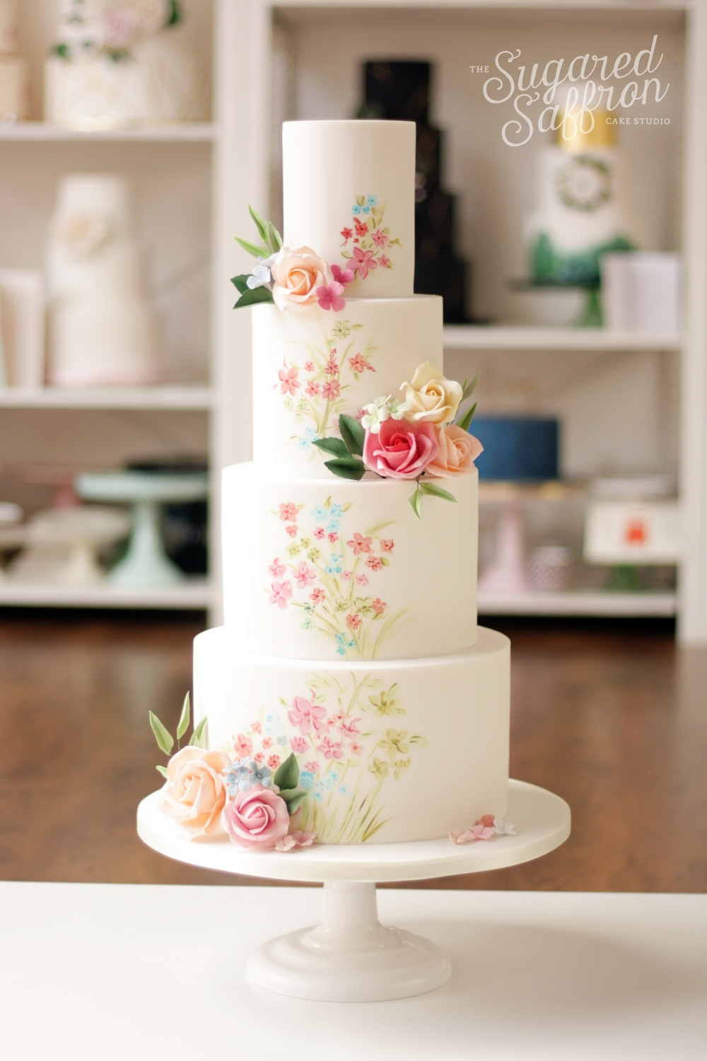 hand painted spring floral design wedding cake with sugar roses